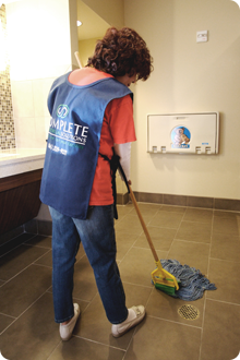CCS Woman Sweeping Bathroom